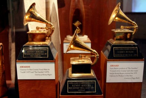 Grammy Award winners Kenny Rogers and Larry Butler statuettes are on display.