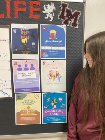 Senior Arianne Spenneman checks out the dress-up day themes for homecoming 2021.